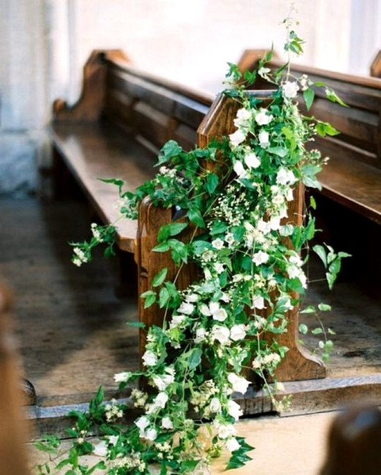 Floral decorated church wedding aisle