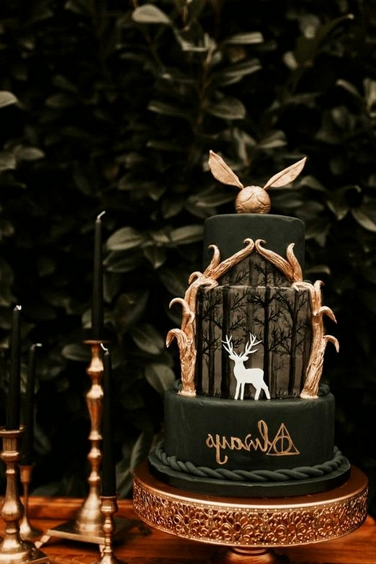 Moody emerald greena and gold harry potter themed wedding cake
