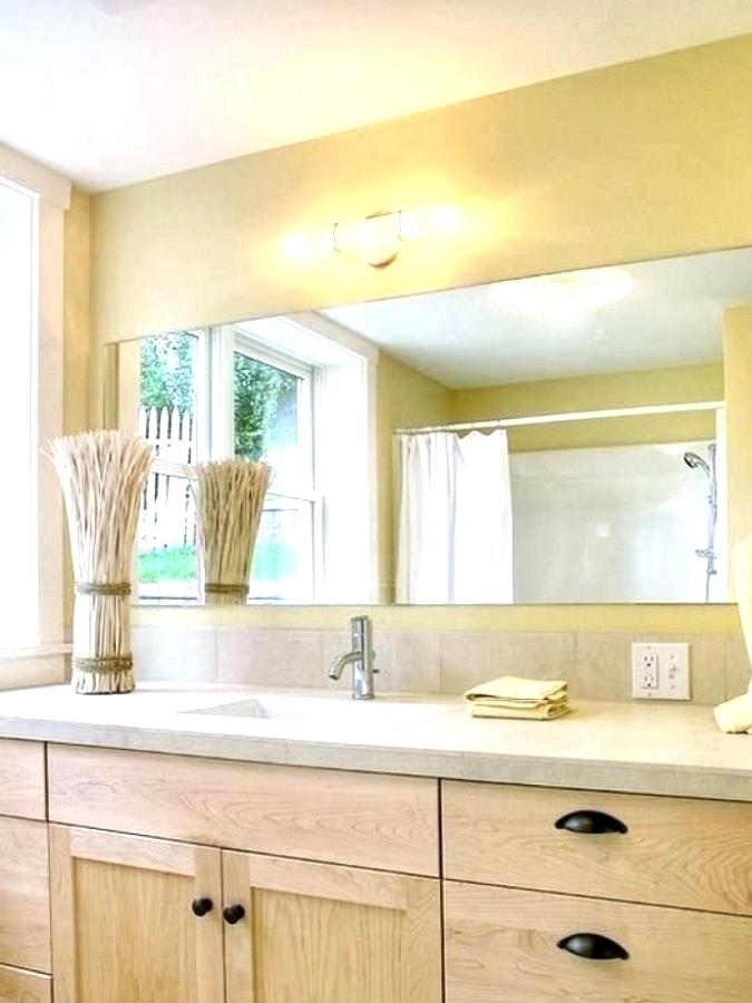 Install A Large Mirror bathroom