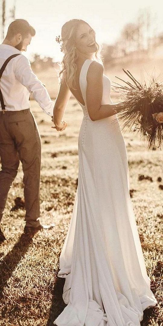 simple elegant wedding dress with v back