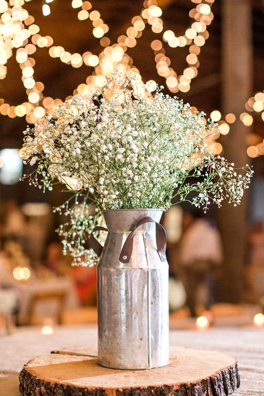 diy country rustic wedding centerpiece with tree stumps