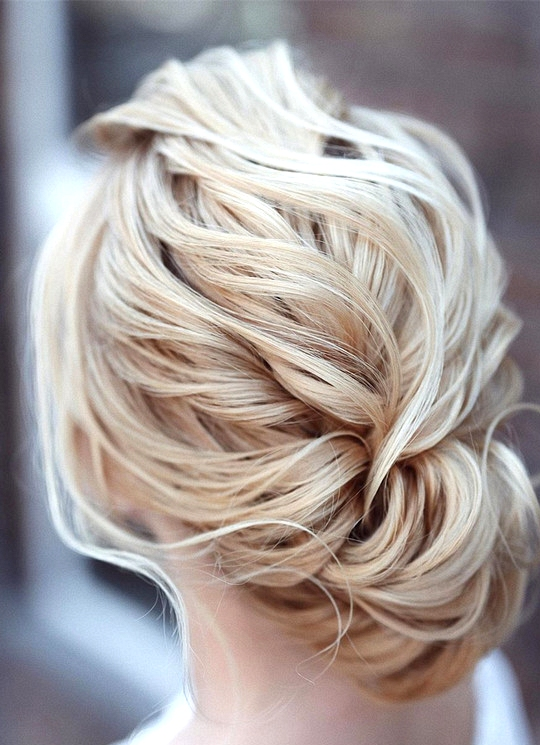 elegant updo wedding hairstyles for 2020 brides 12