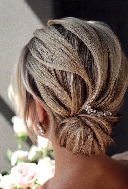 elegant updo wedding hairstyles for 2020 brides 14