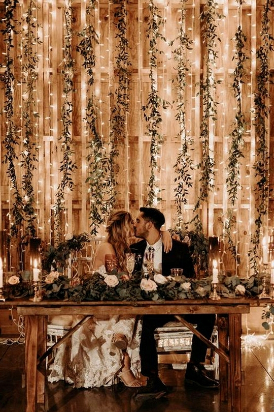 string lights and greenery wedding backdrop ideas