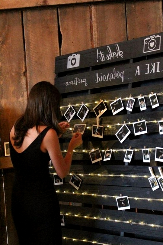 rustic barn wedding photo display ideas with string lights