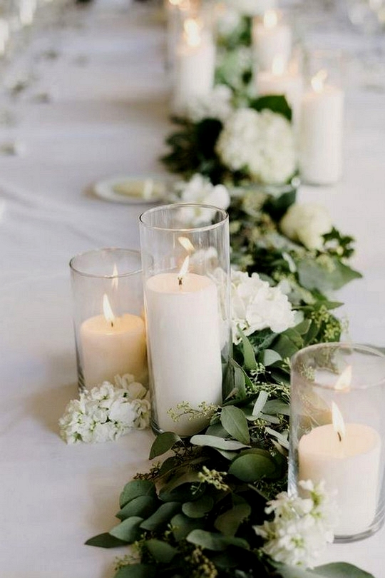 candles and seeded eucalyptus wedding centerpiece with candles