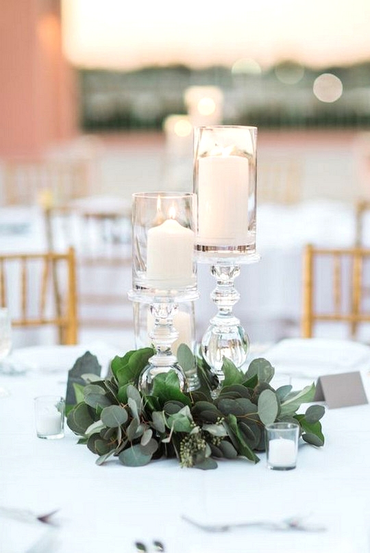 simple greenery wedding centerpiece with candles