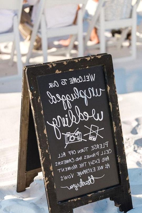 Unplugged wedding sign at a beach wedding