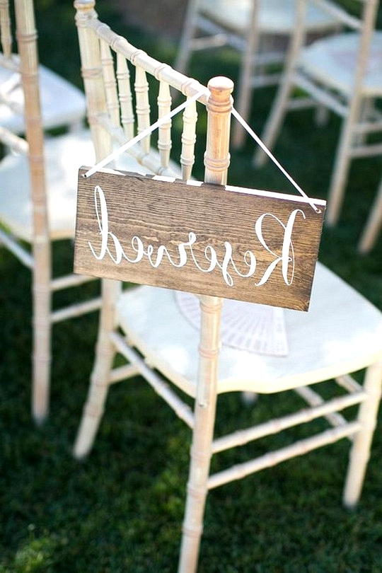 simple wood reserved sign for wedding ceremony
