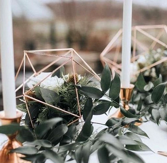 rose gold geometric wedding centerpiece with greenery and candles