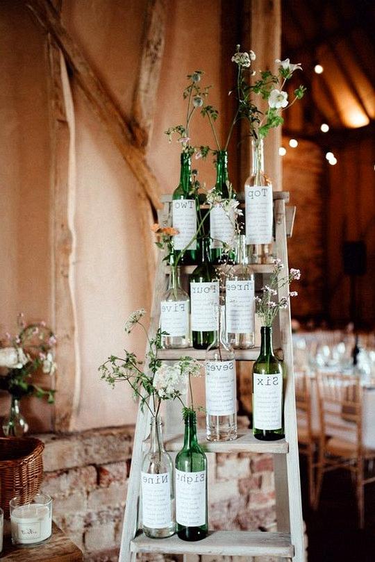 wine bottle wedding table plan ideas on vintage ladder