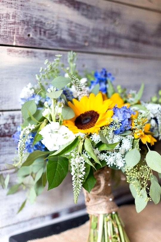 sunflowers blue hydrangea and eucalyptus wedding bouquet
