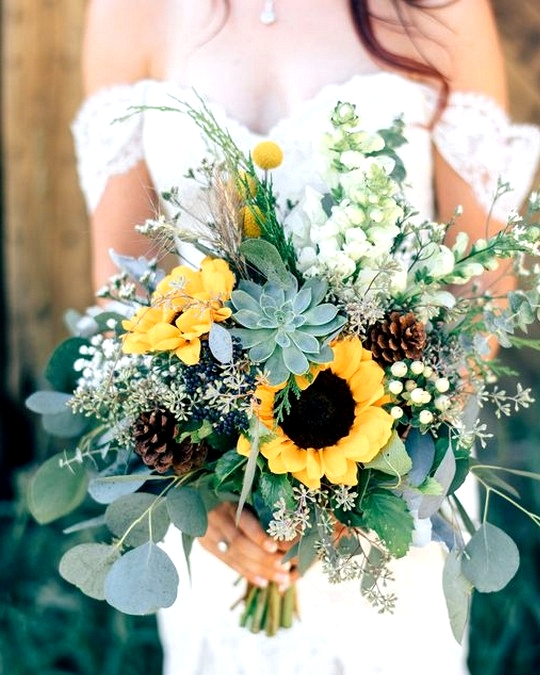 pretty sunflower wedding bouquet with succulents