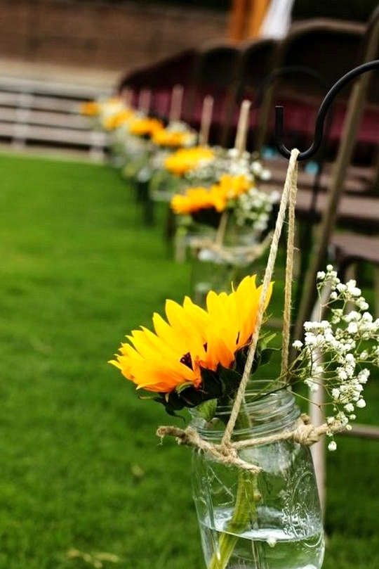outdoor wedding aisle decorations with mason jars and sunflowers