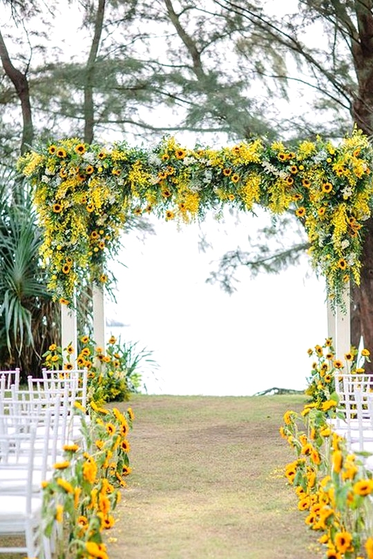 wedding arch and aisle ideas with sunflowers