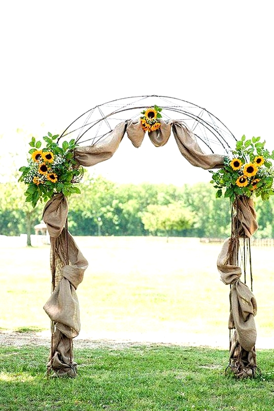 country wedding arch with sunflowers and burlap