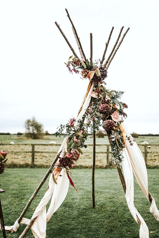 boho inspired naked Tipi wedding arch