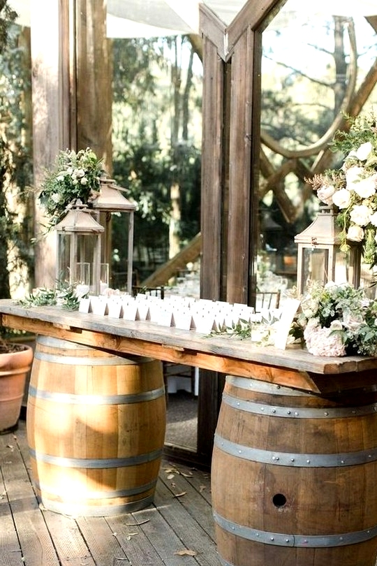 rustic wedding reception decorations with wine barrels