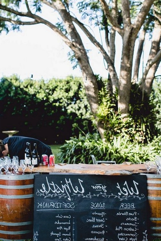 outdoor wedding drink station with wine barrels