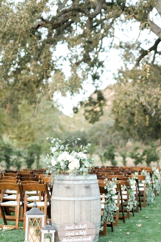 outdoor wedding aisle ideas with wine barrels