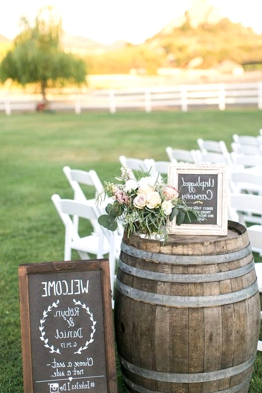 outdoor country wedding ceremony ideas with wine barrles