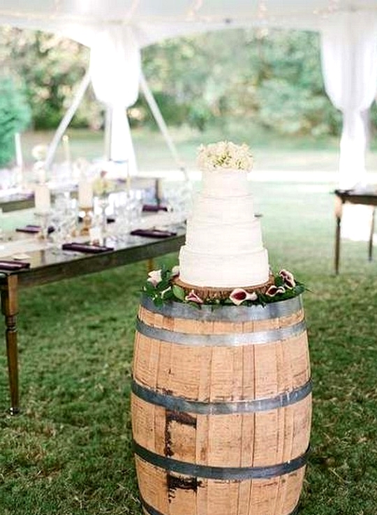 tented wedding cake display ideas with wine barrels