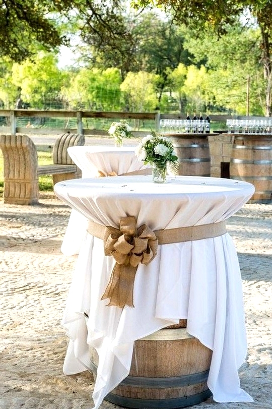 wines barrels as outdoor wedding cocktail tables