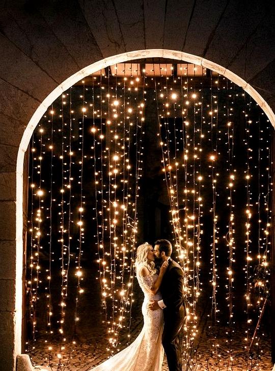 fairytale night wedding photo bride and groom with twinkle lights