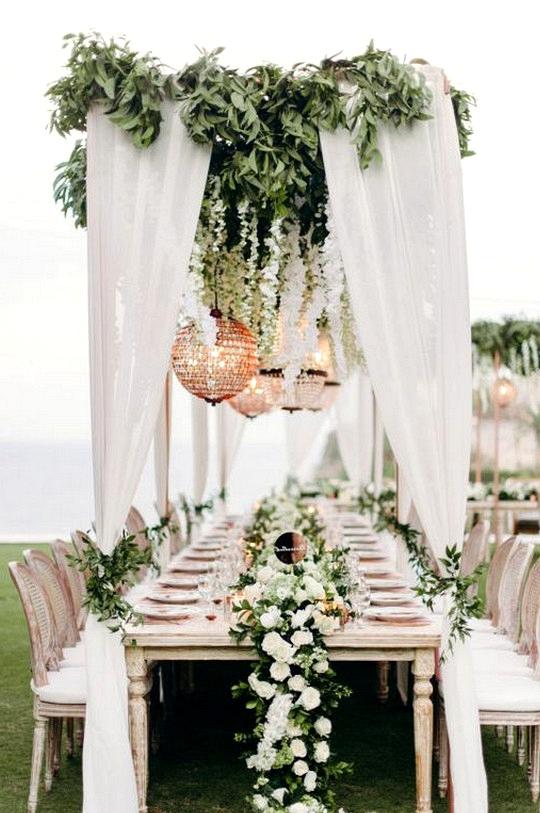 stunning white and greenery beach wedding reception