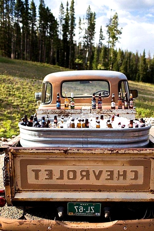 country rustic wedding drink station in a chevrolet
