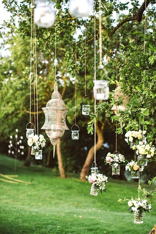 outdoor wedding decoration ideas with hanging cans and jars