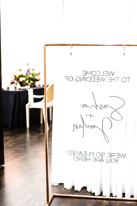 modern acrylic wedding welcome sign with copper stand