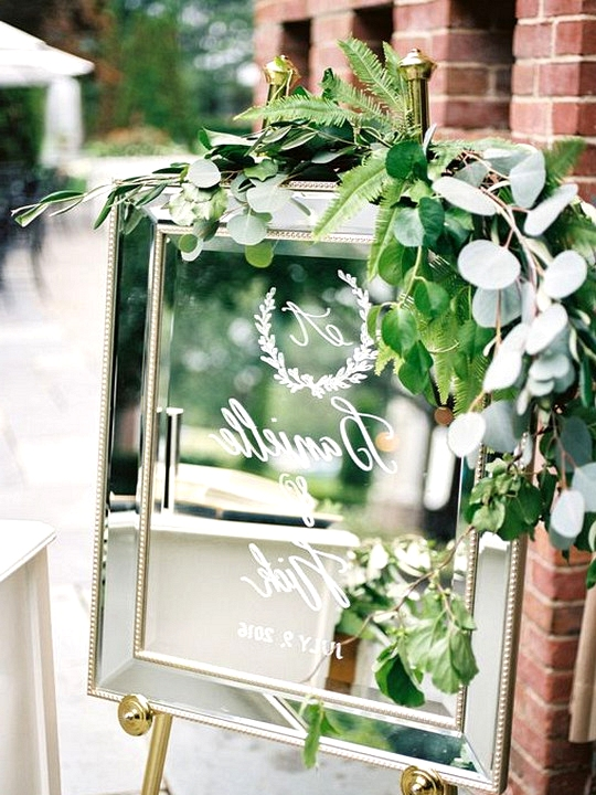 elegant mirror wedding sign with greenery