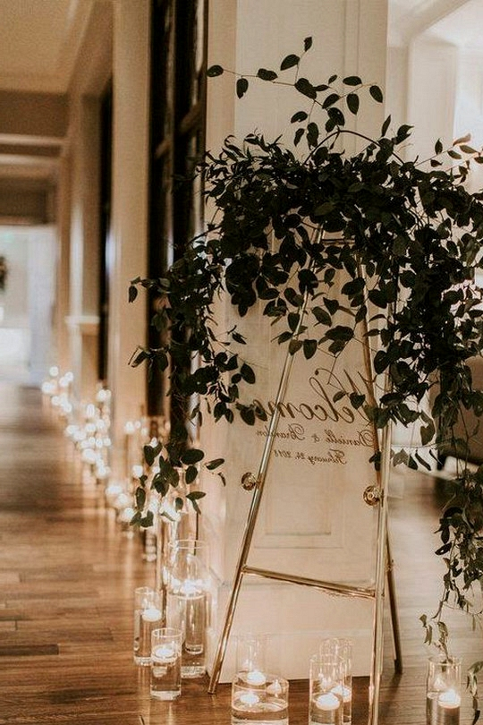 modern acrylic wedding sign ideas with greenery and candles