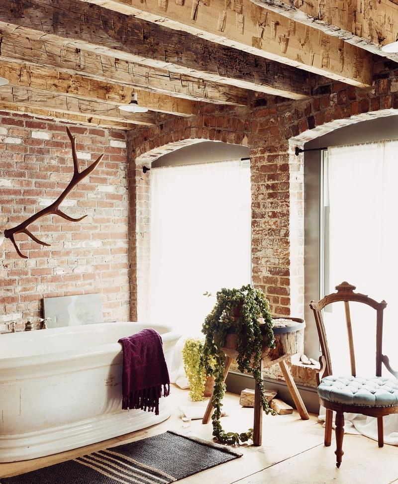 Rustic bathroom with brick wall