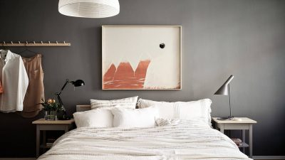 Gray bed room with heat accents