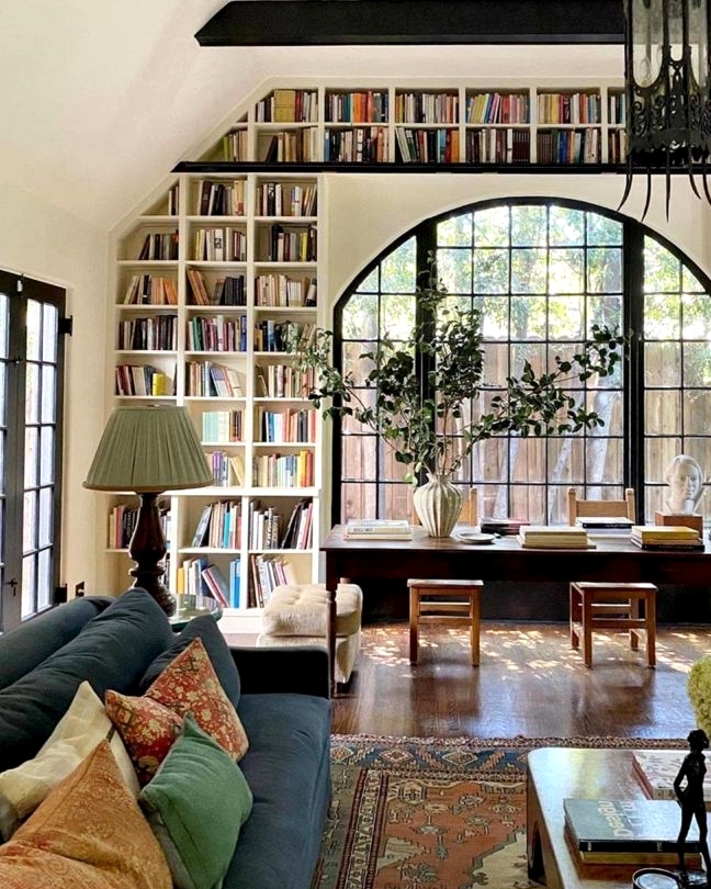 Historic Landmark living room with large built-in Bookshelves around window