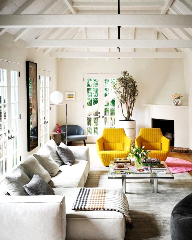 artsy and fun living room decorating idea with yellow armchairs