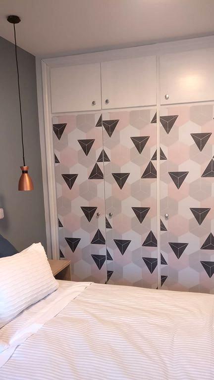 Built-in-wardrobe-renovated-with-self-adhesive-vinyl-washable-opaque-nordic-hexagons-pink-lokoloko