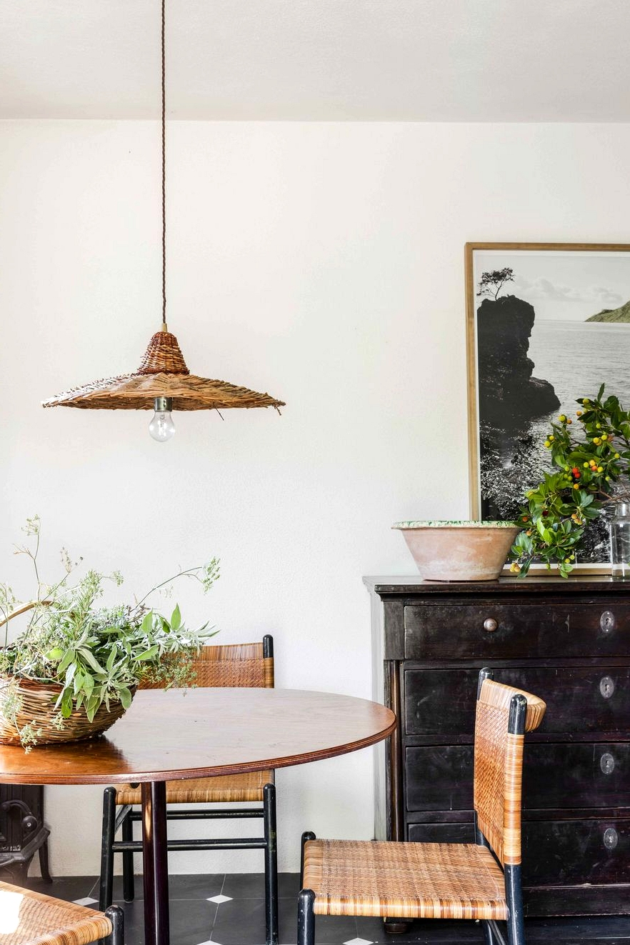 mix of antiques in a small italian vacation home dining room