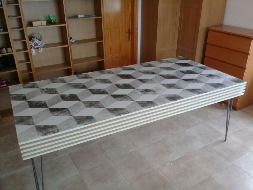 Living-room-table-lined-with-self-adhesive-vinyl-worn-out-cubes-for-rental-floors-lokoloko