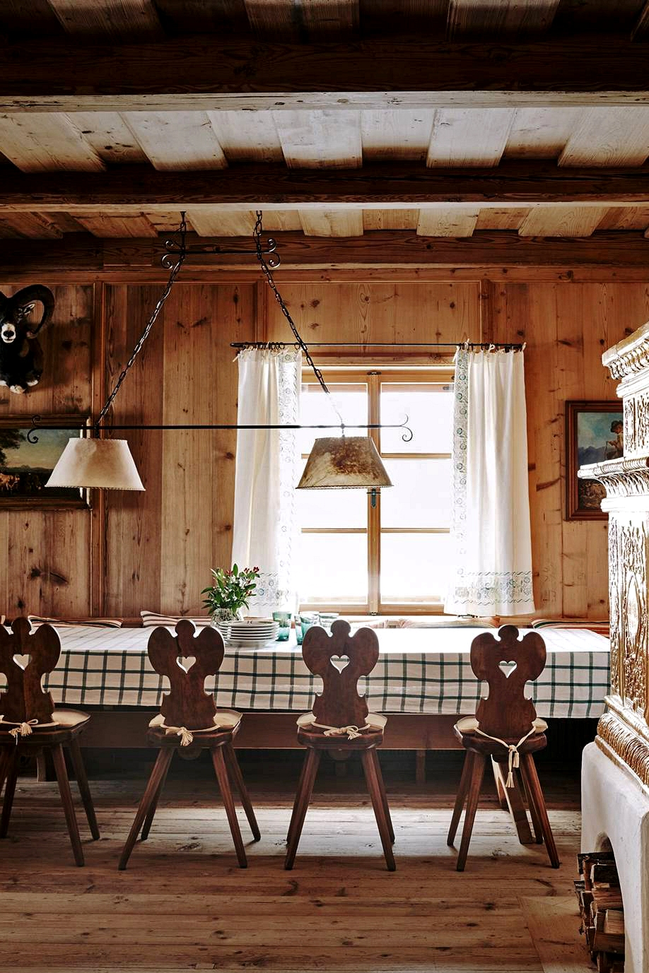 alpine house tour classic austrian chairs and checkered tablecloth