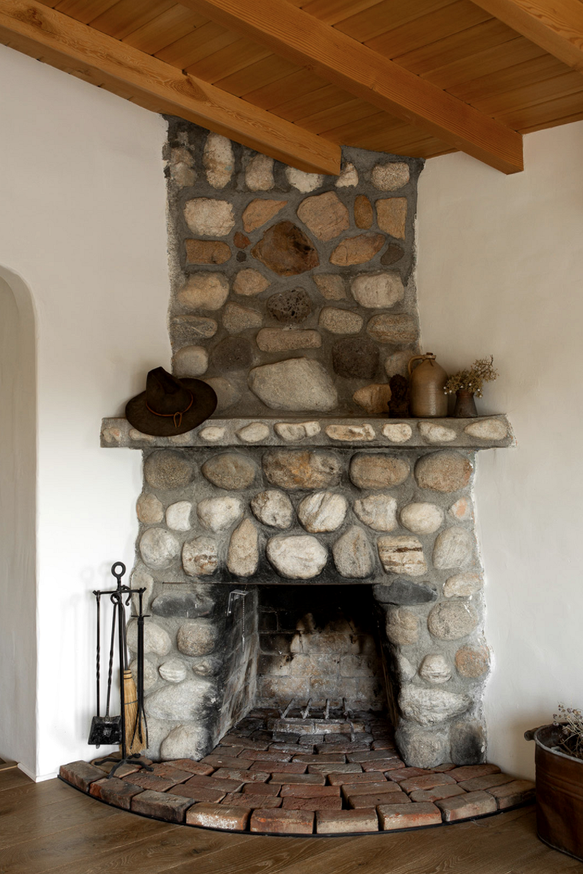 modern desert adobe house tour stone fireplace