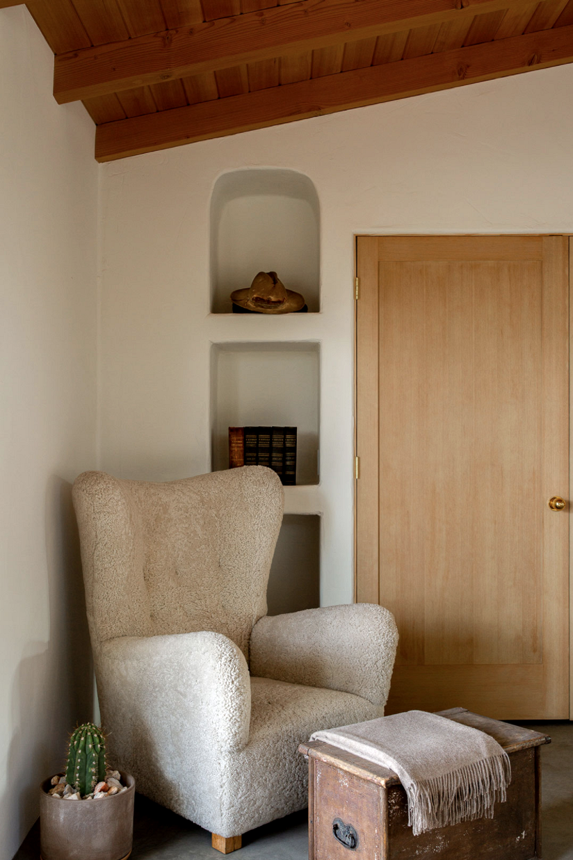 modern desert adobe house tour cozy corner shearling chair